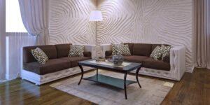 Pokój dzienny w stylu Art Deco. Panele podłogowe, skórzane sofy, dekoracyjna lampa i płytki ścienne.
